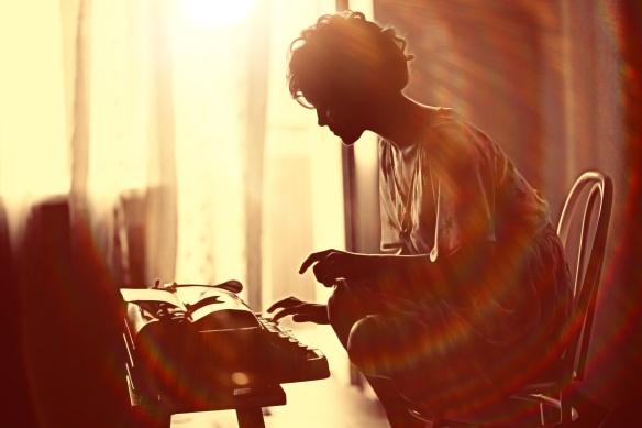 girl typing on a typewriter
